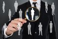 Businessman searching candidate with magnifier Royalty Free Stock Photo