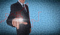 Businessman selecting a labyrinth on blue background Royalty Free Stock Image