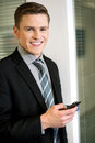 Businessman sending text message corporate guy texting via cellphone Royalty Free Stock Photos