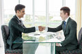 Businessman shaking hand business situation in office Stock Images