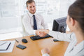 Businessman shaking hands with a colleague Royalty Free Stock Photo