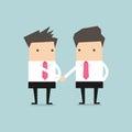 Businessman shaking hands congratulating