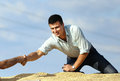 Businessman shaking hands with worker on soybean heap young satisfied sitting soybeans and Royalty Free Stock Photos