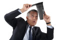 Businessman shielding himself with folder Royalty Free Stock Photo