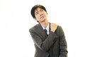 Businessman with shoulder pain tired and stressed asian Stock Photos