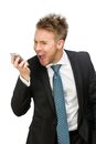 Businessman shouting at cell phone half length portrait of isolated on white Stock Photography