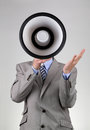 Businessman shouting through a megaphone into concept for communication news announcement and business motivation Royalty Free Stock Photos