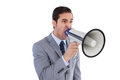 Businessman shouting into a megaphone on white background Royalty Free Stock Photos