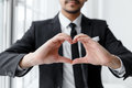 The businessman show heart shape with his hand. Royalty Free Stock Photo