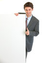 Businessman showing blank billboard and thumbs up Royalty Free Stock Image
