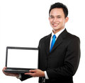 Businessman showing a blank laptop Royalty Free Stock Photo