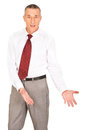 Businessman showing copyspace on the floor Royalty Free Stock Images