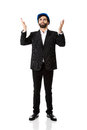 Businessman showing empty copyspace in hands happy engineer on Royalty Free Stock Photo