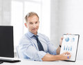 Businessman showing graphs and charts picture of handsome Stock Photography