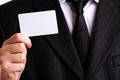 Businessman showing his business card Stock Photo