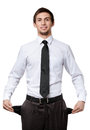 Businessman showing his empty pockets Stock Image
