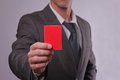 Businessman showing red card. Business and finance concept Royalty Free Stock Photo