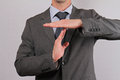 Businessman showing time out sign with hands close up. Royalty Free Stock Photo