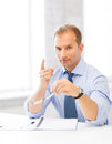Businessman showing warning gesture handsome with spectacles Royalty Free Stock Photos