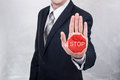 Businessman shows stop sign painted on the hand Royalty Free Stock Photo