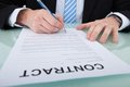 Businessman signing contract paper at office desk Royalty Free Stock Photo