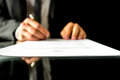 Businessman signing a document with focus to the text Contract Royalty Free Stock Photo