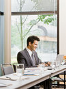 Businessman sitting alone in conference room Royalty Free Stock Images