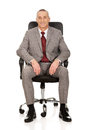 Businessman sitting on armchair Royalty Free Stock Photo