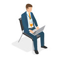 Businessman Sitting on Chair with Laptop and Typing Royalty Free Stock Photo