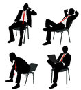Businessman sitting on the chair silhouettes Royalty Free Stock Images