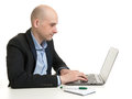 Businessman sitting at desk working on laptop computer young isolated Royalty Free Stock Images