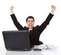 Businessman sitting at his desk rejoicing throwing arms up in the air and shouting with glee success Royalty Free Stock Images