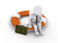Businessman sitting on lifebuoy Royalty Free Stock Photography