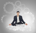Businessman sitting in lotus position on a cloud Royalty Free Stock Photo