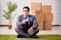 The businessman sitting on office floor