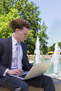 Businessman Sitting Outdoors With Laptop Royalty Free Stock Photo