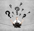 Businessman sitting rope question mark Royalty Free Stock Photography