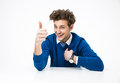 Businessman sitting at the table with thumb up happy Royalty Free Stock Photos