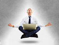 Businessman sitting in yoga position Royalty Free Stock Photo