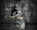 Businessman skating on money skateboard across metal euro symbol with dark concrete room background Royalty Free Stock Images