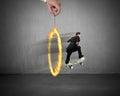 Businessman skating on money skateboard through fire circle Royalty Free Stock Photo