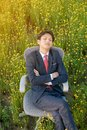 Businessman sleeping in flower field Royalty Free Stock Photo