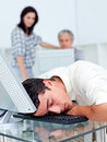 Businessman sleeping on his keyboard Royalty Free Stock Photos