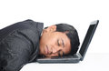Businessman sleeping over the laptop indian Stock Image