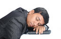 Businessman sleeping over the laptop indian Royalty Free Stock Images