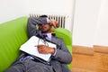 Businessman sleeping on a sofa Royalty Free Stock Photo