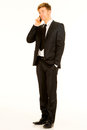 Businessman with smartphone standing talking on the phone Stock Image