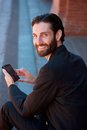 Businessman smiling with cell phone Royalty Free Stock Photo