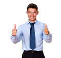 Businessman smiling with his thumbs up a portrait of a on blue shirt and tie in ok sign while is looking at you on isolated Royalty Free Stock Image