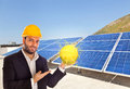 Businessman with solar panel Royalty Free Stock Photo